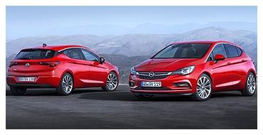 Dwa czerwone samochody marki opel